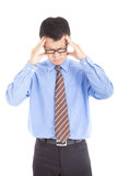 Businessman having headache Royalty Free Stock Image