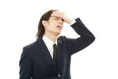 Businessman having a headache Stock Photo