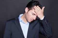 Businessman having headache royalty free stock photography
