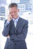 Businessman having a headache Royalty Free Stock Photo