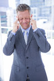 Businessman having a headache Royalty Free Stock Image