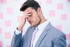 Businessman having headache Royalty Free Stock Photography