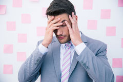Businessman having headache Stock Photos