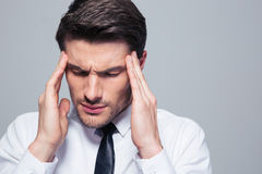 Businessman having headache Stock Image