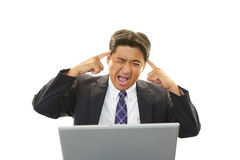 Businessman having a headache Stock Photo