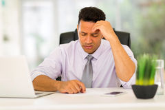 Businessman having headache Stock Images