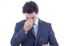 Businessman having headache Royalty Free Stock Image