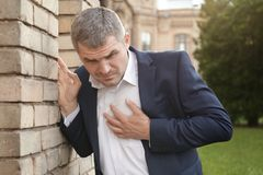 Businessman having heart attack Royalty Free Stock Photography