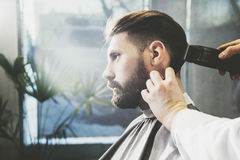 Businessman having his hair trimmed royalty free stock image