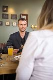Businessman Having Meal With Female Colleague Royalty Free Stock Images
