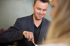 Businessman Having Meal With Female Colleague Royalty Free Stock Photography