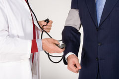 Businessman having a medical check up Royalty Free Stock Images