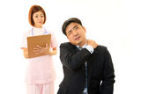 Businessman having a pain in the shoulder Royalty Free Stock Photography
