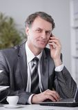 Businessman having phone call conversation at workplace Stock Images
