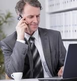 Businessman having phone call conversation at workplace Stock Photo