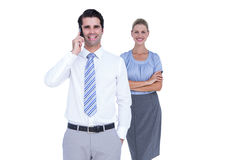 Businessman having phone call while his colleague posing Royalty Free Stock Photo