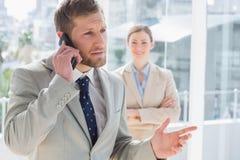 Businessman having phone conversation Stock Photo