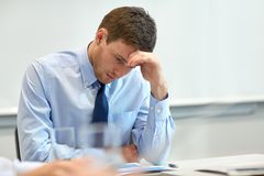 Businessman having problem in office Royalty Free Stock Photography