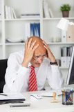 Businessman having problems with computer. Desperate businessman having problems with computer Royalty Free Stock Photography