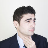 Businessman with sore throat royalty free stock image