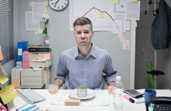 Businessman having a sad lunch Stock Images