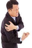 Businessman having shoulder pain Royalty Free Stock Photos