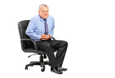 Businessman having a stomach ache. On white background stock photo