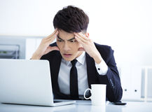 Businessman having stress in the office Royalty Free Stock Photography