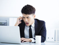 Businessman having stress and surprised in the office Royalty Free Stock Photos