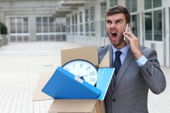 Businessman having a tantrum on the phone after being fired.  royalty free stock photo