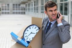 Businessman having a tantrum on the phone after being fired.  royalty free stock photos