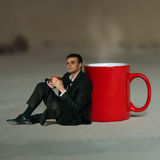 Businessman having tea Royalty Free Stock Photography