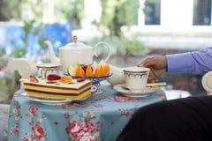 Businessman having  tea with cake and fresh fruit Stock Photos