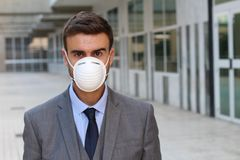 Businessman having to use a mask to walk around the polluted city royalty free stock photos