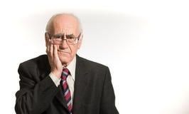 Businessman having tooth pain Stock Image