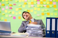 The businessman having trouble with his priorities royalty free stock image