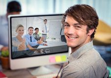 Businessman having video call with colleagues on desktop computer. At office Royalty Free Stock Photography