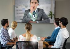 Businessman having a video call with colleagues. At office Royalty Free Stock Images