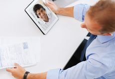Businessman having video call on tablet pc royalty free stock photos