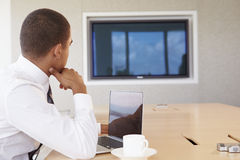 Businessman Having Video Conference In Boardroom Stock Image