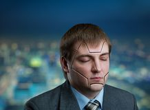 Businessman head with cracks on his face Royalty Free Stock Photo