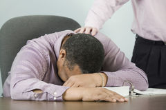 Businessman with head on desk. Stock Photo