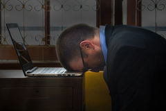 Businessman head down on his labtop Royalty Free Stock Images
