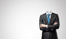 Businessman without head. Headless businessman with arms crossed on chest in black suit Royalty Free Stock Photography