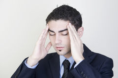 Businessman with headache. Businessman having strong headache with hands on his head stock photo