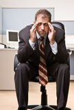 Businessman with headache Stock Image