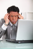 Businessman with a headache Royalty Free Stock Photo