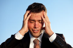 Businessman with a headache caused by stress Royalty Free Stock Photography