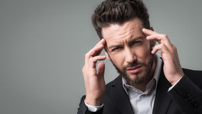 Businessman with headache head in hands Stock Photo