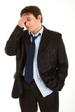 Businessman with headache holding hand at head Royalty Free Stock Images
